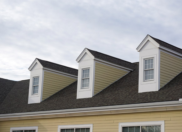 Photo of shingled roofing.